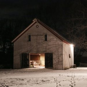 John R Park Homestead at night covered in snow