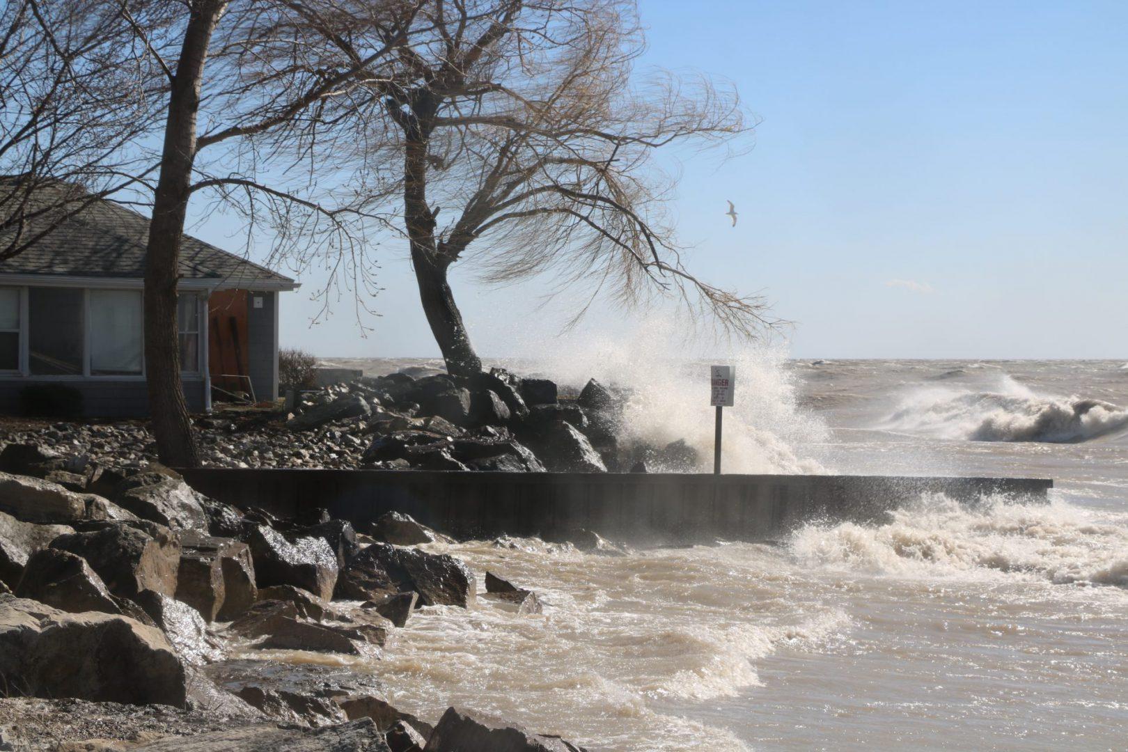 waves crashing over a shoreline