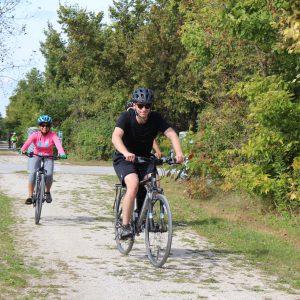 Bike Tour participants riding along trail