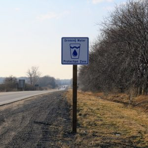 Sign adjacent to road identifying a Drinking Water Protection Zone.