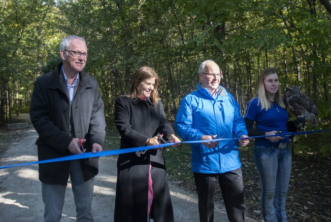 Ribbon cutting along the newly opened Caesars Windsor Nature Trail.