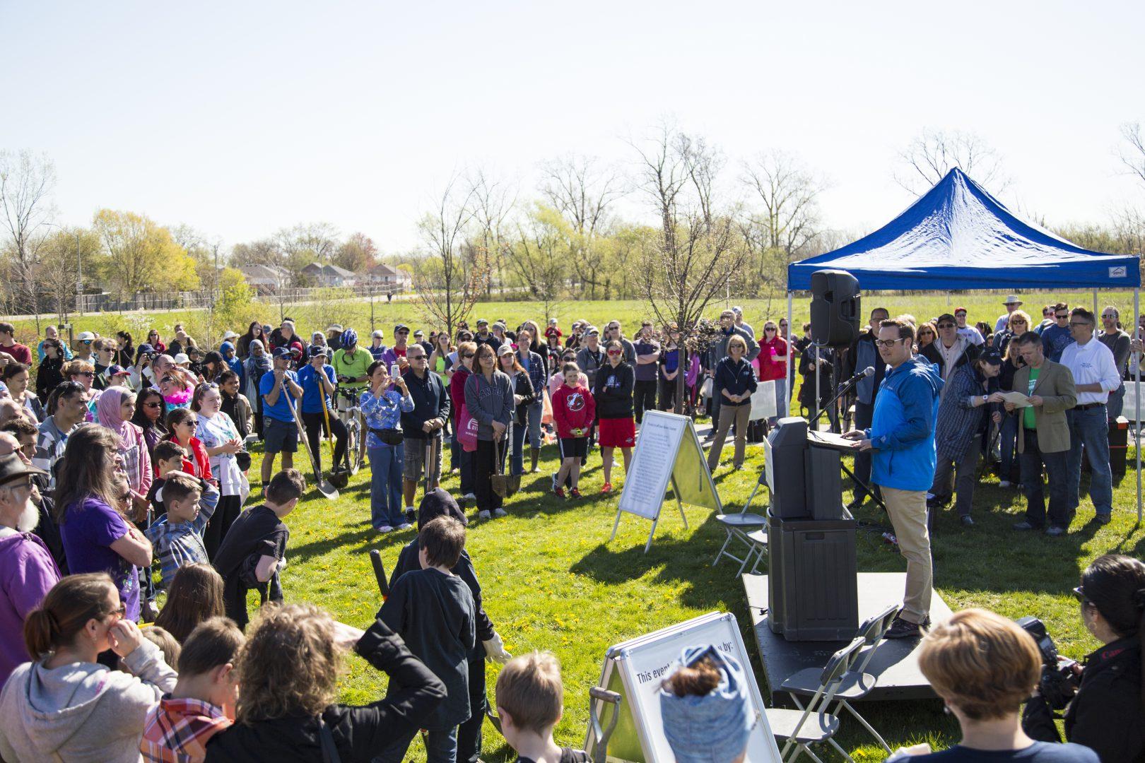People gathered around a public speaker