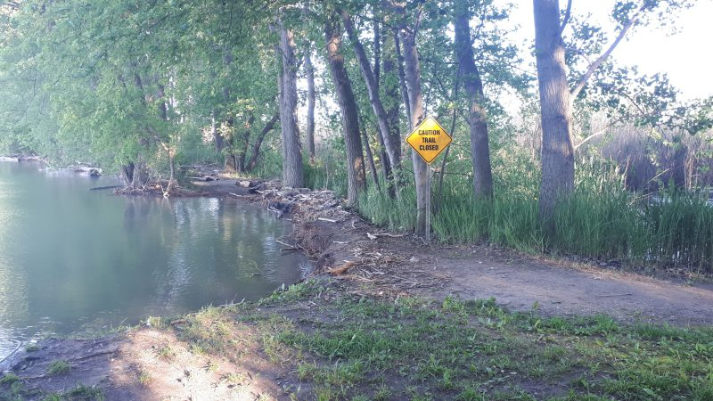 a blocked and flooded trail head