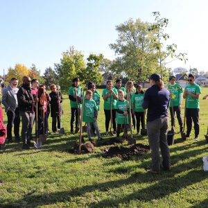 ERCA teaching residents how to plant trees