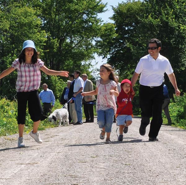 a family on the greenway trail
