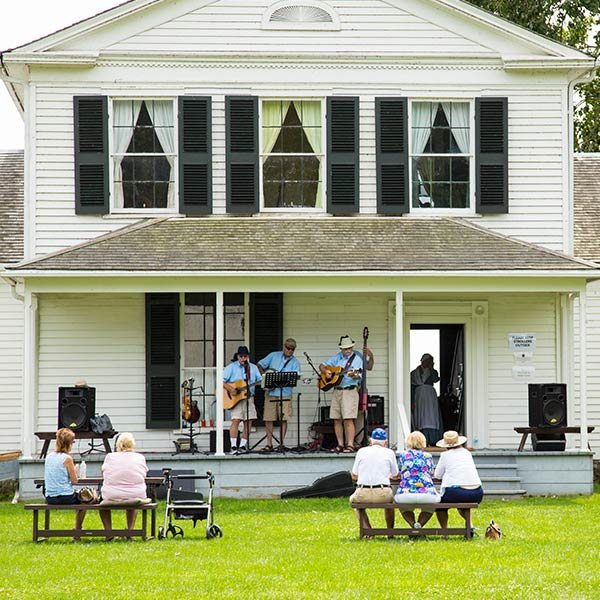 Homestead-House-band-performs-on-porch-small