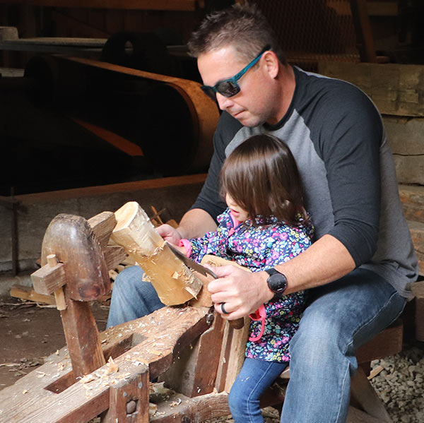 JRPH-Sawmill-father-helps-girl-shave-wood