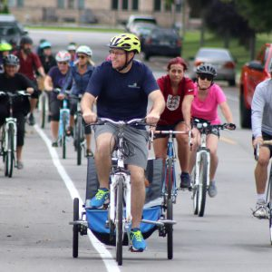 Cyclists riding down a road in Kingsville