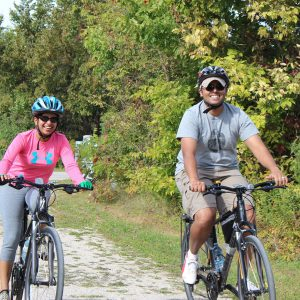 a couple cycling on the greenway
